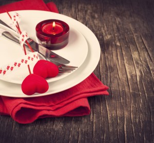 Festive table setting for Valentine's Day with fork, knife and h
